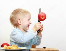 kitchen knives for children blond boy child kid preschooler with kitchen knife cutting fruit
