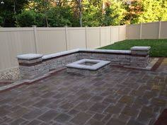 Unilock Fire Pit by Outdoor Living Area Using Brussels Block Sierra Pavers And