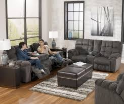 reclining sofa with drop down table and cup holders by signature