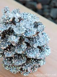 learn how to make knockoff pottery barn glitter and snow pinecones