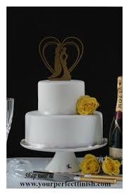 romantic gold cake topper perfect for your wedding cake