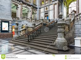 main hall with clock of art deco station of antwerp belgium stock