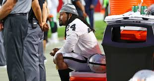 marshawn lynch sits during national anthem at raiders preseason game