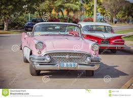 Old Classic Cars - pink white red old classic vintage retro cars editorial stock