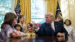 trump oval office pictures trump invites reporters u0027 kids in costume into the oval office