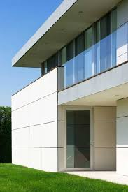 grass landscape with white exterior wall for modern concrete home