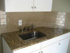 Backsplash With Venetian Gold Granite - example of new venetian gold granite in white kitchen with subway