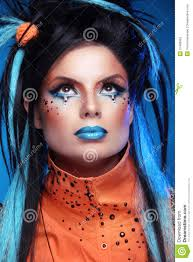 makeup punk hairstyle close up portrait of rock with blue