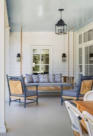 best 25 wicker porch furniture ideas on pinterest white wicker white and blue covered patio features a blue beadboard ceiling accented with a rope and salvaged wood swinging sofa lined with blue pillows facing a pair of