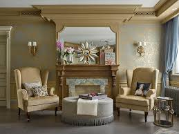 tan walls stone fireplace surround mantel wall art high ceilings