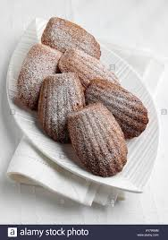 a plate of madeleines traditional french cakes editorial food