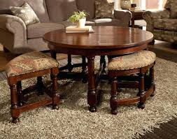 glass coffee table with ottomans underneath coffee table with