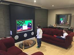 in wall speakers home theater false chimney with recessed tv in wall speakers and pj screen in