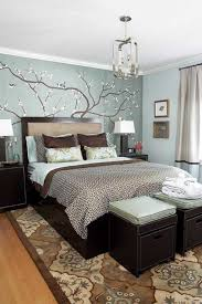 brown wooden floor blue wall white ceiling brown wooden bedside