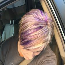 pink highlighted hair over 50 blonde pixie haircut with purple and fuchsia highlights hair