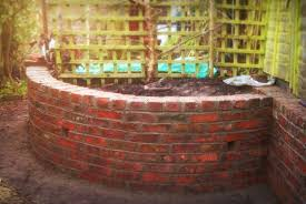 reclaimed brick planter retaining wall blue slate path newnham on