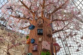 artificial tree birds and birdhouses at gum store editorial photo