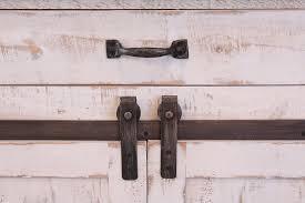 distressed white kitchen island burleson home furnishings anton white sliding barn door kitchen