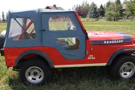 jeep cj renegade is this denim upholstered cj5 the most 1970s jeep ever the drive