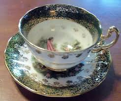 cup and saucer regency courting genuine bone china made in england