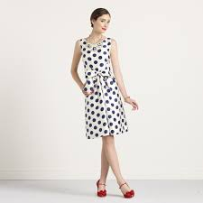 dig the polka dot dress red shoes and vintage chic style