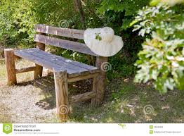 Rustic Outdoor Bench by Sunhat On A Wooden Garden Bench Stock Photo Image 39040460