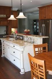 kitchen island with raised bar kitchen island with sink and raised area kitchen islands