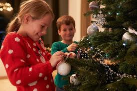 decorating christmas tree as you decorate guard against christmas tree