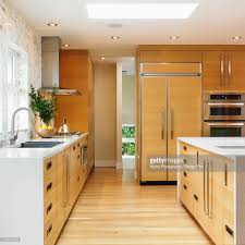 modern galley kitchen with edge grain oak cabinets stock photo
