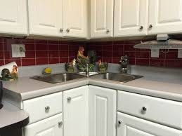 red glass subway tile kitchen backsplash with white cabinet ideas