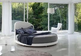 elegant bedroom design with round white beds and drum shape white