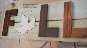 wooden fall sign her tool belt