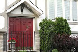red front door white brick house with red front door with brass knocker and