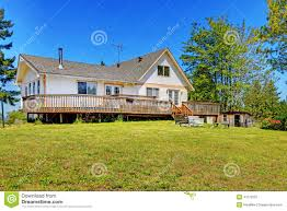 old farm house with walkout deck backyard view stock photo