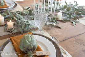 neutral thanksgiving table with seeded eucalyptus seeking