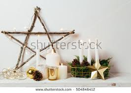 christmas sticks with lights christmas decoration golden ornaments candles lights stock photo