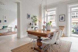 antique table with modern chairs mixing white modern eames chairs with a vintage farm table dining