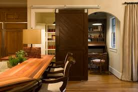 Sliding Barn Door Closet by Interior Brown Wooden Sliding Barn Door With Black Metal Rail And