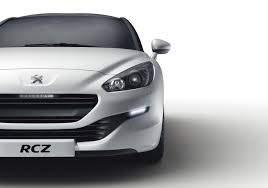 peugeot introduces facelifted rcz and announces 260 bhp rcz r