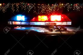 police car lightbar in front of christmas decorations stock photo