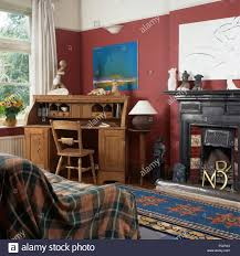 bureau in plaid throw and pine bureau in a nineties living room with a