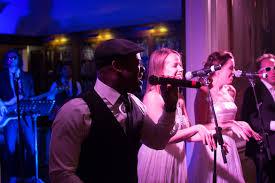 top 100 wedding songs the top 100 songs played at weddings bridalguide