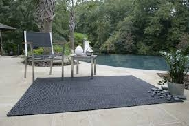 Indoor Outdoor Furniture by Homespice Decor Ultra Durable Black Solid Indoor Outdoor Area Rug