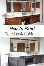 can you paint kitchen cabinets without taking them how to paint dated oak cabinets