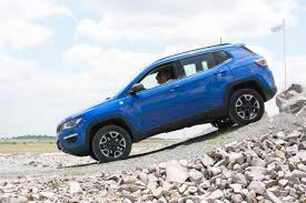 jeep compass limited blue only we can tell you how the jeep compass rides in english driven