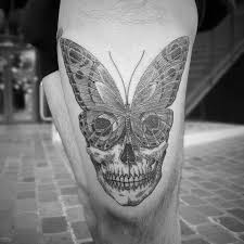 butterfly skull on the left thigh