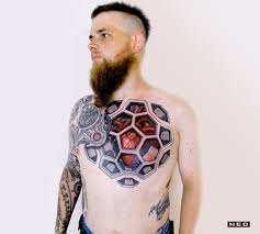 10 artists who create striking geometric tattoos spanning the body