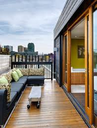 outdoor cool modern patio in rooftop with white pergola and