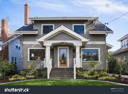 singlefamily american craftsman house blue sky stock photo