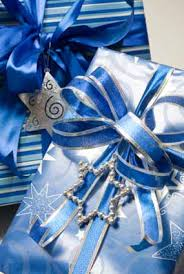 pretty blue wrapping paper and ribbon look tres chic on those